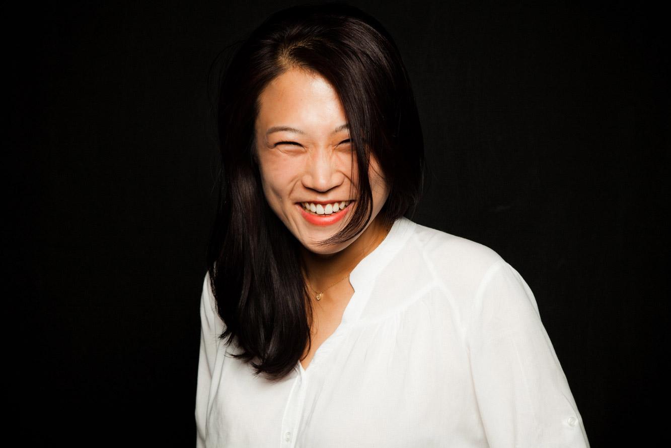 Jongsuk Kim lacht
